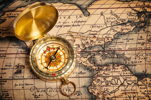 4233973-628931-old-vintage-golden-compass-on-ancient-map